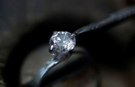 A jeweller repairs a diamond ring in the Clogau workshop in Bodelwyddan, North Wales, Britain, March 12, 2018. REUTERS/Phil Noble