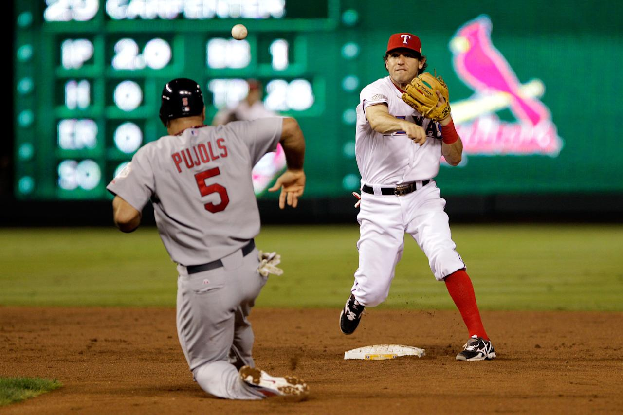 ARLINGTON, TX - OCTOBER 24: Ian Kinsler #5 of the Texas Rangers turns the double play as Albert Pujols #5 of the St. Louis Cardinals slides into second base in the third inning during Game Five of the MLB World Series at Rangers Ballpark in Arlington on October 24, 2011 in Arlington, Texas.  (Photo by Rob Carr/Getty Images)