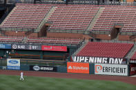 St. Louis Cardinals catcher Yadier Molina warms up in front of empty seats before the start of an opening day baseball game against the Pittsburgh Pirates Friday, July 24, 2020, in St. Louis. (AP Photo/Jeff Roberson)