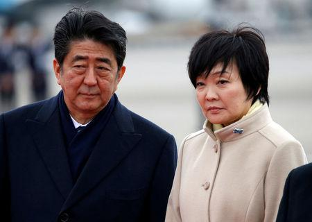FILE PHOTO: Japan's Prime Minister Shinzo Abe and his wife Akie send off Emperor Akihito and Empress Michiko boarding a special flight for their visit to Vietnam and Thailand, at Haneda Airport in Tokyo