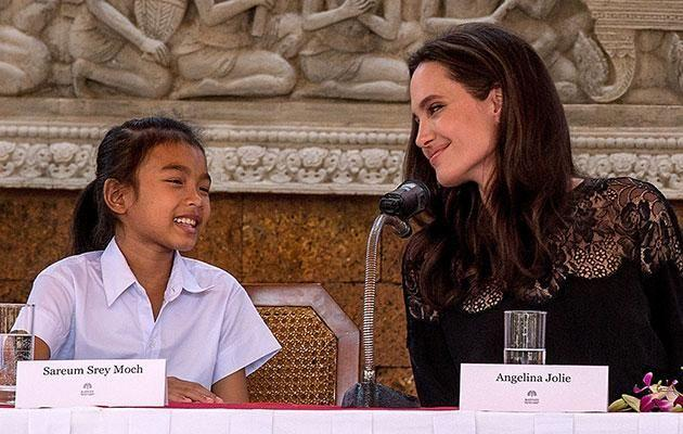 Ange with Cambodian child Srey Moch, who was cast in the film. Source: Getty