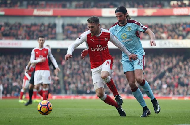 <p>Aaron Ramsey takes on Burnley's George Boyd </p>
