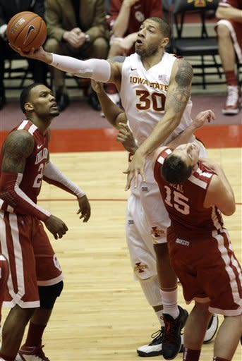 Iowa State forward Royce White (30) drives to the basket over Oklahoma's Romero Osby, left, and Tyler Neal (15) during the first half of an NCAA college basketball game, Saturday, Feb. 18, 2012, in Ames, Iowa. (AP Photo/Charlie Neibergall)