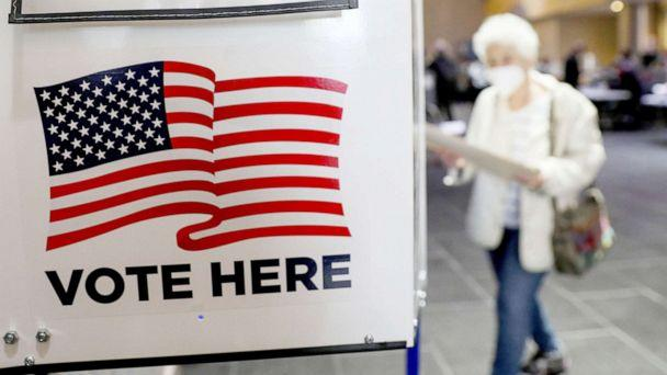PHOTO: A voter walks towards a booth to fill out her ballot during the in-person early voting at a polling station in Lincoln Center in New York, Oct. 24, 2020. (Xinhua News Agency/Getty Images)