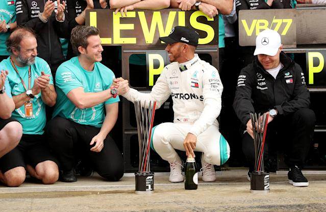 Formula One F1 - Spanish Grand Prix - Circuit de Barcelona-Catalunya, Barcelona, Spain - May 13, 2018 Mercedes' Lewis Hamilton and Valtteri Bottas celebrate with their team after finishing first and second respectively REUTERS/Albert Gea