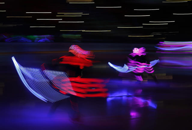 <p>Actors perform before a gala match of the Night Hockey League teams in the Bolshoy Ice Arena in the Black Sea resort of Sochi, Russia, May 10, 2017. (Photo: Yuri Kochetkov/AP) </p>