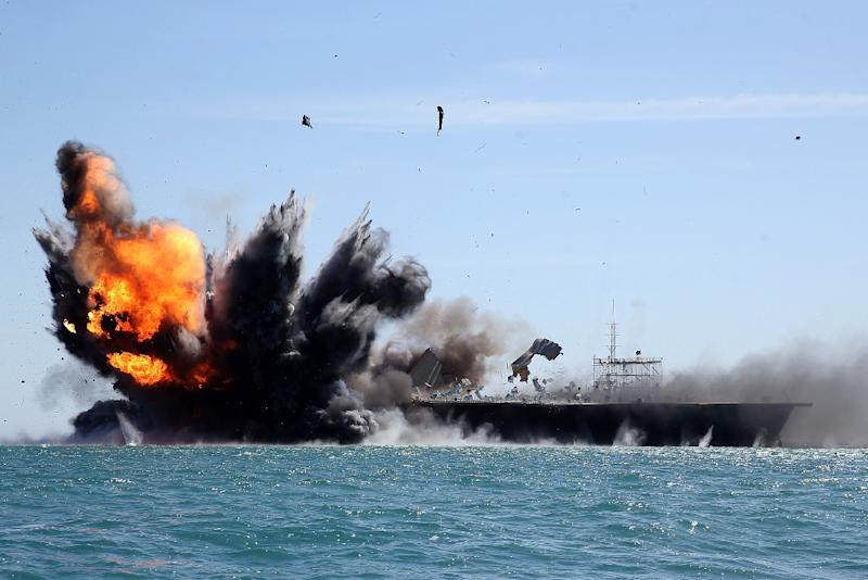 Iran's Revolutionary Guards attack a naval vessel during an exercise in the Strait of Hormuz on February 25, 2015 (AFP Photo/Hamed Jafarnejad)