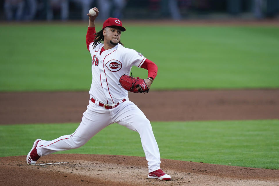 Cincinnati Reds starting pitcher Luis Castillo (58) pitches during the first inning of a baseball game against the Kansas City Royals at Great American Ballpark in Cincinnati, Tuesday, August 11, 2020. (AP Photo/Bryan Woolston)
