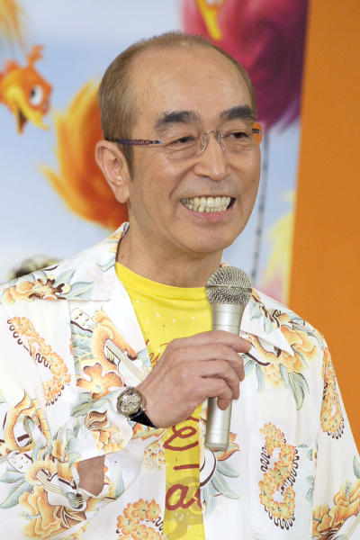 In this September 2012, photo, Japanese comedian Ken Shimura speaks during a campaign for an animation film in Tokyo. The nationally popular Japanese comedian, who said was drawing inspired from Jerry Lewis,  has died of the COVID-19 pneumonia, a first known celebrity victim of the virus in Japan. He was 70. Shimura had been treated at a Tokyo hospital, died of the virus Sunday, March 29, 2020, his agency, Izawa Office, said.(Kyodo News via AP)