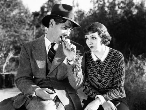 Clark Gable, munching carrots, with Claudette Colbert in 'It Happened One Night' (Columbia/Kobal/Rex/Shutterstock)