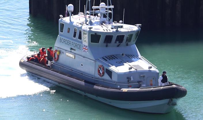 A group of people thought to be migrants are brought into Dover, Kent, on Monday. Priti Patel has called for small boats carrying migrants to be intercepted nearer the French coast. (PA)