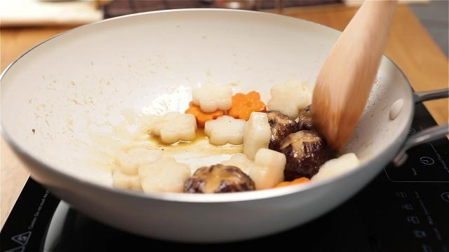 Frying radish, carrots and mushrooms in a pan