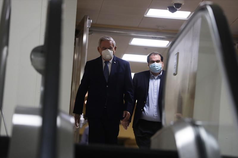 WASHINGTON, DC - MAY 04: U.S. Sen. Robert Menendez (D-NJ) (L) leaves with an aide after a vote at the U.S. Capitol May 4, 2020 in Washington, DC. The Senate came back in session today for the first time since March 25 with enhanced precautions in response to the COVID-19 pandemic. (Photo by Alex Wong/Getty Images)