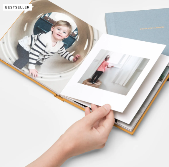 """<p>More time at home means more time to sort through family photos. Head to a site like <a href=""""https://www.artifactuprising.com/photo-books"""" rel=""""nofollow noopener"""" target=""""_blank"""" data-ylk=""""slk:Artifact Uprising"""" class=""""link rapid-noclick-resp"""">Artifact Uprising</a> or <a href=""""https://www.shutterfly.com/photo-books"""" rel=""""nofollow noopener"""" target=""""_blank"""" data-ylk=""""slk:Shutterfly"""" class=""""link rapid-noclick-resp"""">Shutterfly</a> to create a custom photo album highlighting favorite moments together from the past year—think family vacations, birthday parties, holidays, and more. Order a copy for yourself and your mom, then flip through it together in-person or on the phone and relive those blissful times. (Besides, aren't extra photos of grandkids exactly what she needs right now?) </p>"""