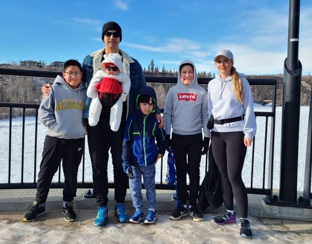 University of Alberta PhD student Grant Bruno, seen here with his family, is studying autism in First Nations communities. (Submitted by Grant Bruno - image credit)