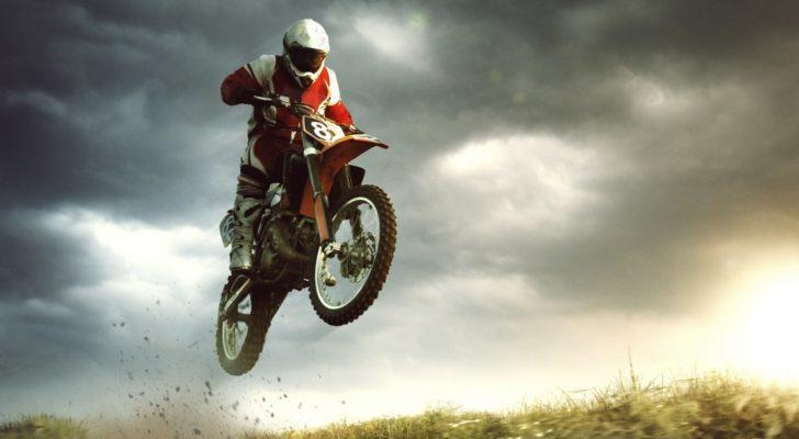 a person on a dirt bike does a jump