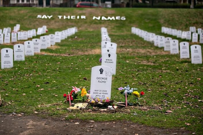 """Mock headstones at the """"Say Their Names' cemetery pay tribute to Black people killed by police."""