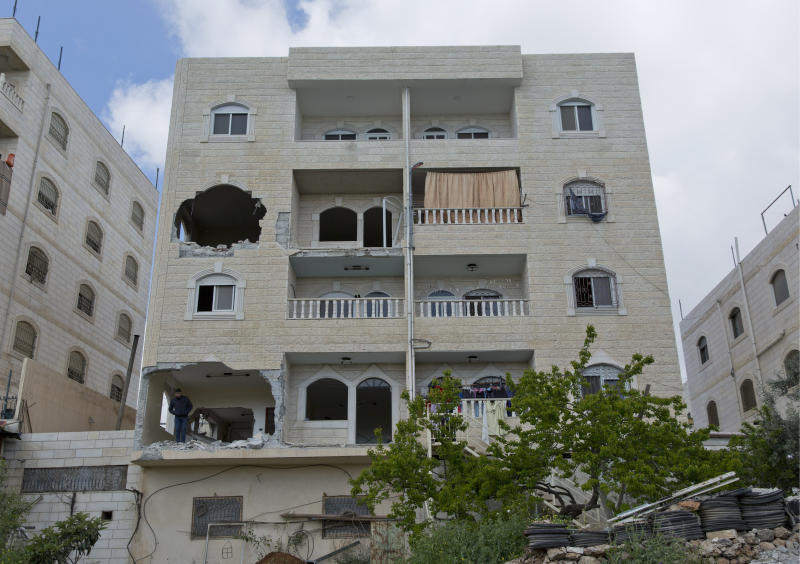 Holes are seen in the two apartments belonging to the father of Arafat Erfayieh, that was bulldozed Israeli forces in the West Bank city of Hebron, Friday, April 19, 2019. The Israeli military has demolished the family home of Erfayieh, a Palestinian charged with the killing of a 19-year-old Israeli woman. (AP Photo/Nasser Nasser)