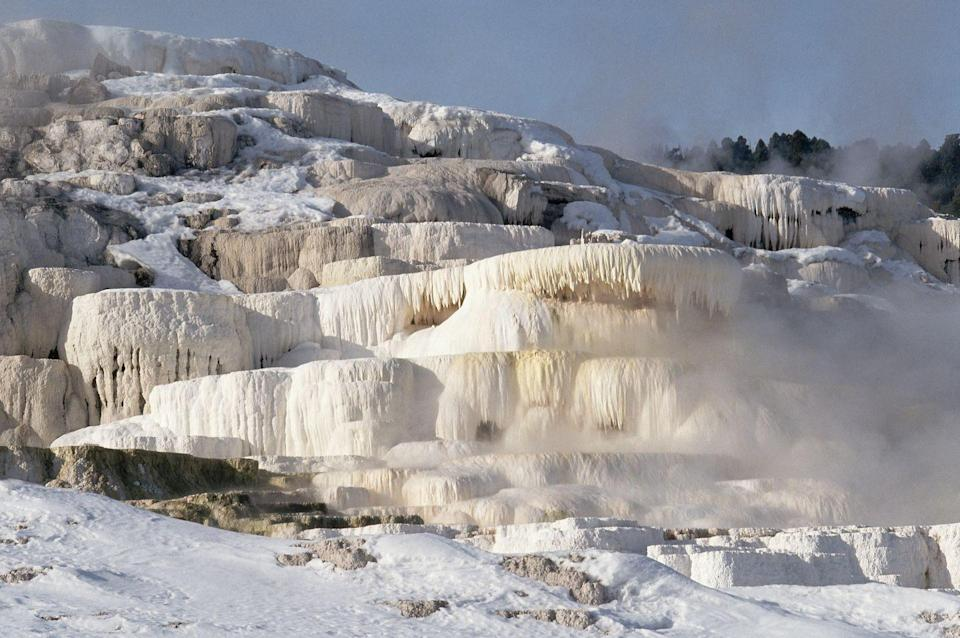 <p>Not quite a waterfall, but these epic hot springs freeze in the funkiest formations when temps drop low enough. </p>