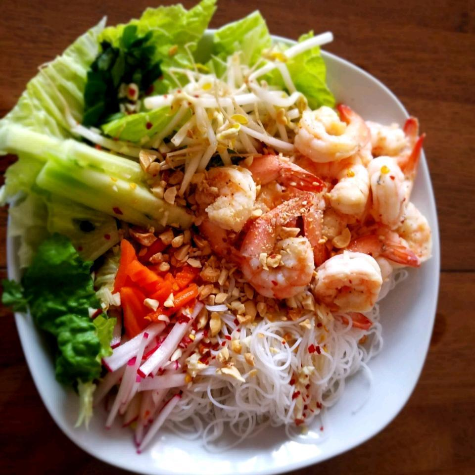 """<p>This simple noodle salad combines fresh herbs, rice vermicelli, cucumber, bean sprouts, and more, topped with grilled shrimp. Tossed with a tangy sweet and sour sauce, it's a simple and satisfying dinner. Reviewer Milly Suaso-Martinez says, """"I made this with what I had on hand... which was NY Strip Steak. I also didn't have the pickled carrots/daikon or cucumbers. However it was very good. I did add a bit more sugar to the sauce because I like it a bit sweeter.""""</p>"""