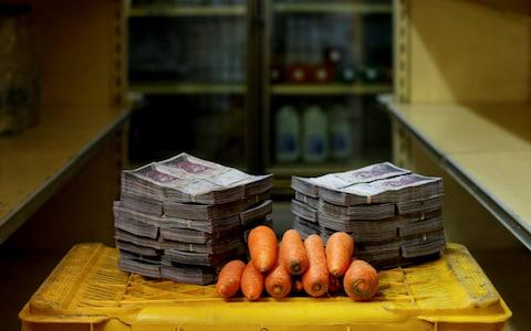 A kilogram of carrots is pictured next to 3,000,000 bolivars, its price and the equivalent of $0.46, at a mini-market in Caracas, Venezuela August 16, 2018. - Credit: Reuters