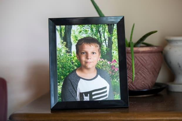 A photo of Carson Crimeni is displayed in his grandfather's home in Langley, British Columbia on Aug. 9, 2019. (Ben Nelms/CBC - image credit)
