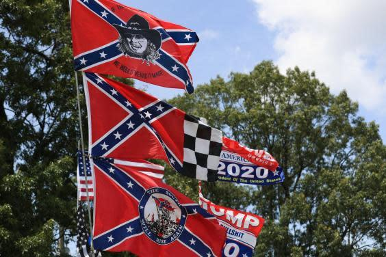 Confederate flag merchandise is seen at a hut across the street from the Talladega Superspeedway prior to the NASCAR Cup Series GEICO 500 on June 22, 2020 in Talladega, Alabama (Getty Images)
