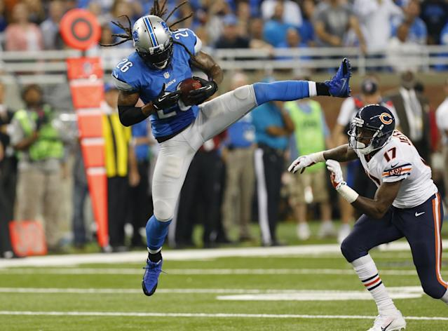 Detroit Lions free safety Louis Delmas (26) intercepts a pass intended for Chicago Bears wide receiver Alshon Jeffery (17) during the third quarter of an NFL football game at Ford Field in Detroit, Sunday, Sept. 29, 2013. (AP Photo/Paul Sancya)