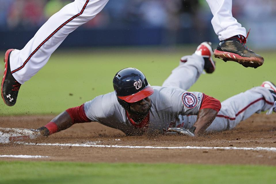 Washington Nationals' Denard Span, bottom, is doubled up at first base by Atlanta Braves first baseman Freddie Freeman on a line drive by Stephen Lombardozzi in the first inning of a baseball game in Atlanta, Friday, May 31, 2013. (AP Photo/John Bazemore)