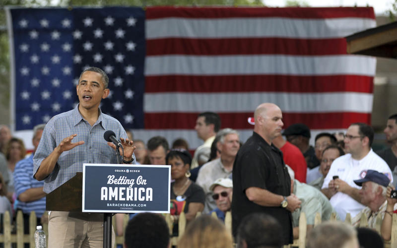 """President Barack Obama speaks at James Day Park Thursday, July 5, 2012, in Parma, Ohio. Obama is traveling through Ohio and Pennsylvania on a two-day """"Betting on America"""" bus tour to highlight commitment to invest in American workers and creating jobs.  (AP Photo/Tony Dejak)"""