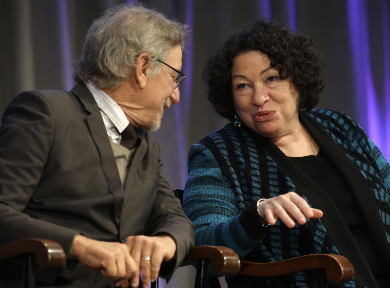 Supreme Court Justice Sonia Sotomayor, right, speaks with film director Steven Spielberg, left, on stage during award ceremonies for the W.E.B. Du Bois Medal winners, on the campus of Harvard University, in Cambridge, Mass., Wednesday, Oct. 2, 2013. Harvard has awarded the medal since 2000 to people whose work has contributed to African and African-American culture. Sotomayor and Spielberg are among the 2013 recipients. (AP Photo/Steven Senne)