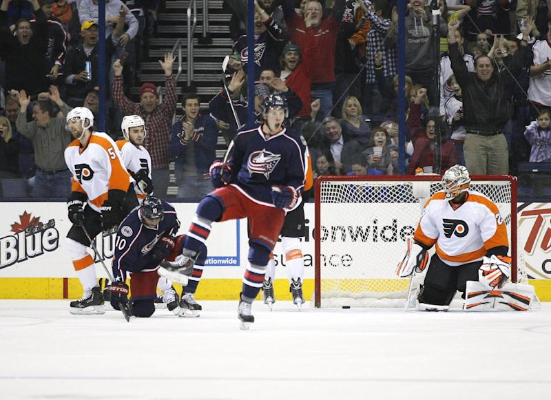 Columbus Blue Jackets' Ryan Johansen (19) celebrates a goal against Philadelphia Flyers goalie Ray Emery (29) during the first period of an NHL hockey game on Saturday, Dec. 21, 2013, in Columbus, Ohio. (AP Photo/Mike Munden)