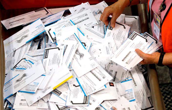 Democrats are pushing to expand voting by mail.
