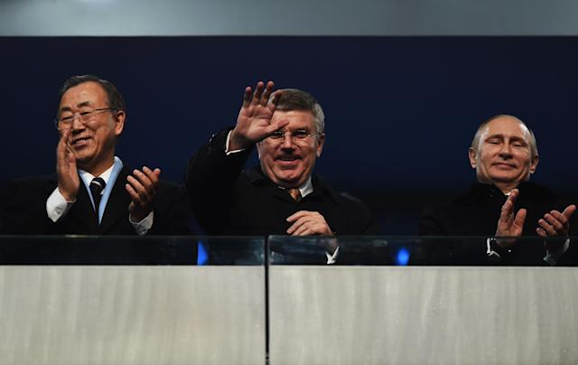 SOCHI, RUSSIA - FEBRUARY 07: International Olympic Committee (IOC) President Thomas Bach (C), Russian President Vladimir Putin (R) and UN Secretary General Ban Ki-moon wave to the crowd during the Opening Ceremony of the Sochi 2014 Winter Olympics at Fisht Olympic Stadium on February 7, 2014 in Sochi, Russia. (Photo by Pascal Le Segretain/Getty Images)