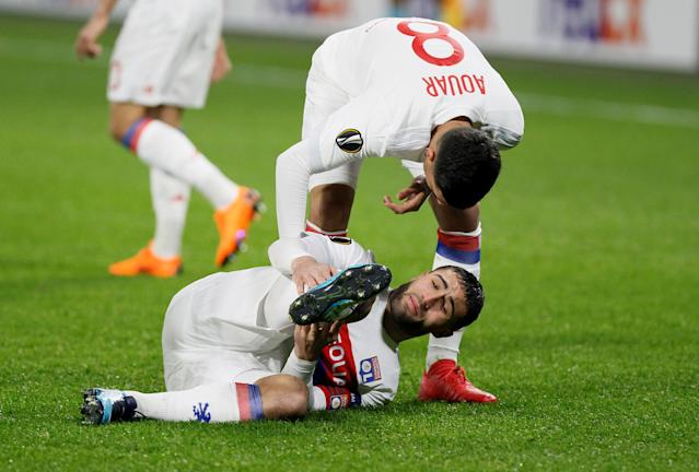 Soccer Football - Europa League Round of 32 First Leg - Olympique Lyonnais vs Villarreal - Groupama Stadium, Lyon, France - February 15, 2018 Lyon's Houssem Aouar checks on Nabil Fekir after he sustained an injury REUTERS/Emmanuel Foudrot