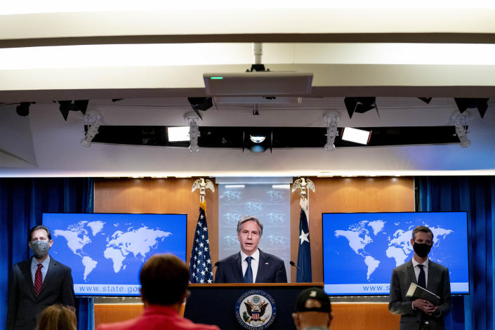 Secretary of State Antony Blinken, center, accompanied by International Religious Freedom Senior Official Dan Nadel, left, and State Department spokesman Ned Price, right, speaks at a news conference to announce the annual International Religious Freedom Report at the State Department in Washington, Wednesday, May 12, 2021. (AP Photo/Andrew Harnik, Pool)