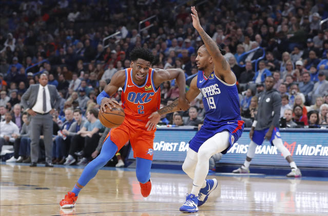 Oklahoma City Thunder guard Shai Gilgeous-Alexander (2) drives to the basket around Los Angeles Clippers guard Rodney McGruder (19) during the second quarter of an NBA basketball game Sunday, Dec. 22, 2019, in Oklahoma City. (AP Photo/Alonzo Adams)