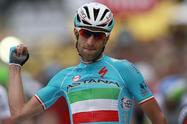 Italy's Vincenzo Nibali crosses the finish line to win the second stage of the Tour de France cycling race over 201 kilometers (124.9 miles) with start in York and finish in Sheffield, England, Sunday, July 6, 2014. (AP Photo/Peter Dejong)