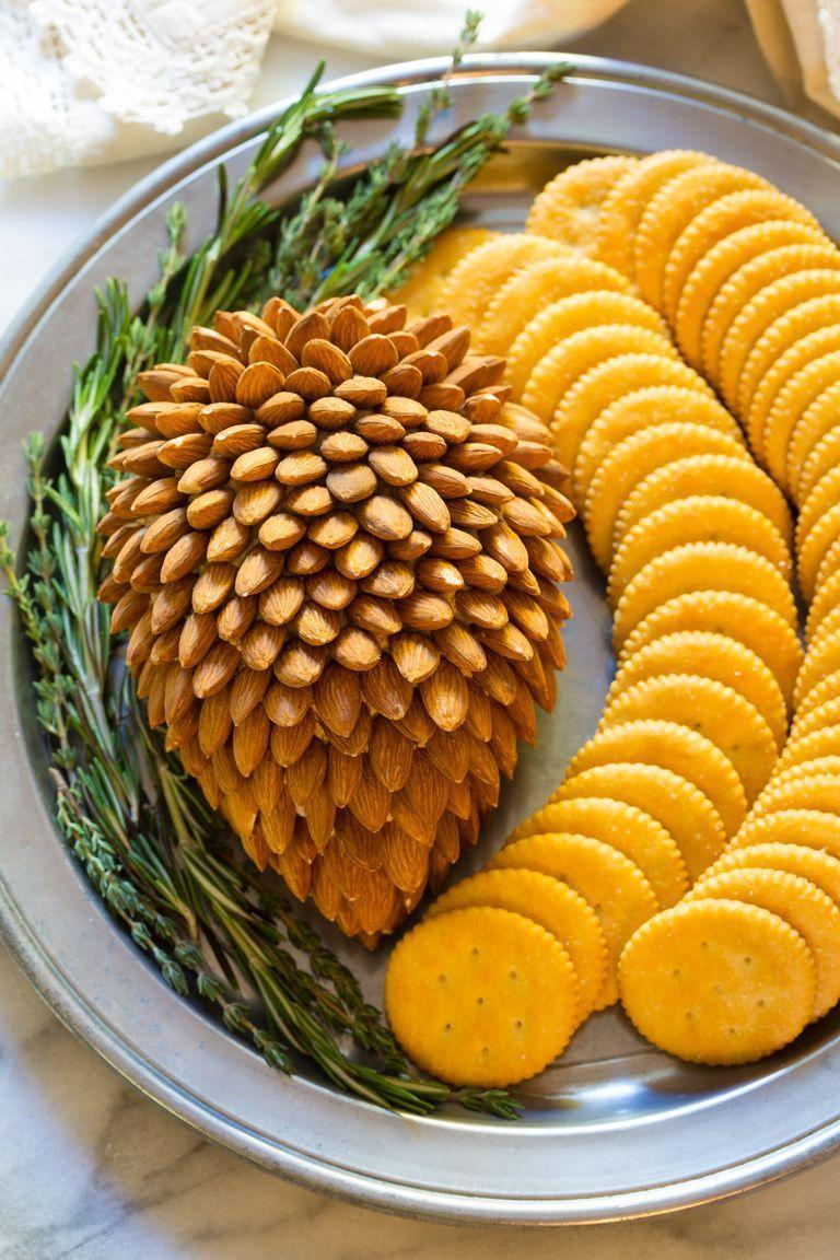 """<p>There are two secret ingredients that make this cheese ball extra tasty. And talk about a seasonal presentation!</p><p><strong><a href=""""https://www.thepioneerwoman.com/food-cooking/recipes/a81851/holiday-cheese-ball/"""" rel=""""nofollow noopener"""" target=""""_blank"""" data-ylk=""""slk:Get the recipe."""" class=""""link rapid-noclick-resp"""">Get the recipe.</a></strong></p><p><strong><a class=""""link rapid-noclick-resp"""" href=""""https://go.redirectingat.com?id=74968X1596630&url=https%3A%2F%2Fwww.walmart.com%2Fsearch%2F%3Fquery%3Dcheese%2Bknives&sref=https%3A%2F%2Fwww.thepioneerwoman.com%2Ffood-cooking%2Fmeals-menus%2Fg34272733%2Fchristmas-party-appetizers%2F"""" rel=""""nofollow noopener"""" target=""""_blank"""" data-ylk=""""slk:SHOP CHEESE KNIVES"""">SHOP CHEESE KNIVES</a><br></strong></p>"""