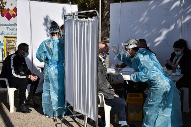 PHOTO: People are tested for COVID-19 by medical staff in the waterfront of Thessaloniki, Greece, on Oct. 29, 2020. (Sakis Mitrolidis/AFP via Getty Images)