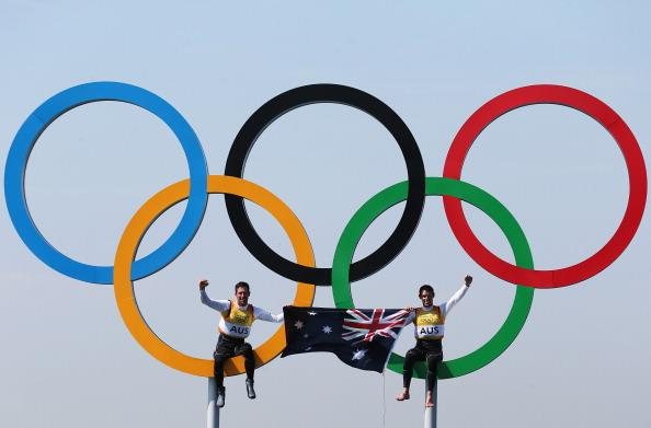 WEYMOUTH, ENGLAND - AUGUST 10:  Mathew Belcher (R) and Malcolm Page (L) of Australia celebrate in the Olympic rings after winning gold in the Men's 470 Sailing on Day 14 of the London 2012 Olympic Games at the Weymouth & Portland Venue at Weymouth Harbour on August 10, 2012 in Weymouth, England. (Photo by Clive Mason/Getty Images)