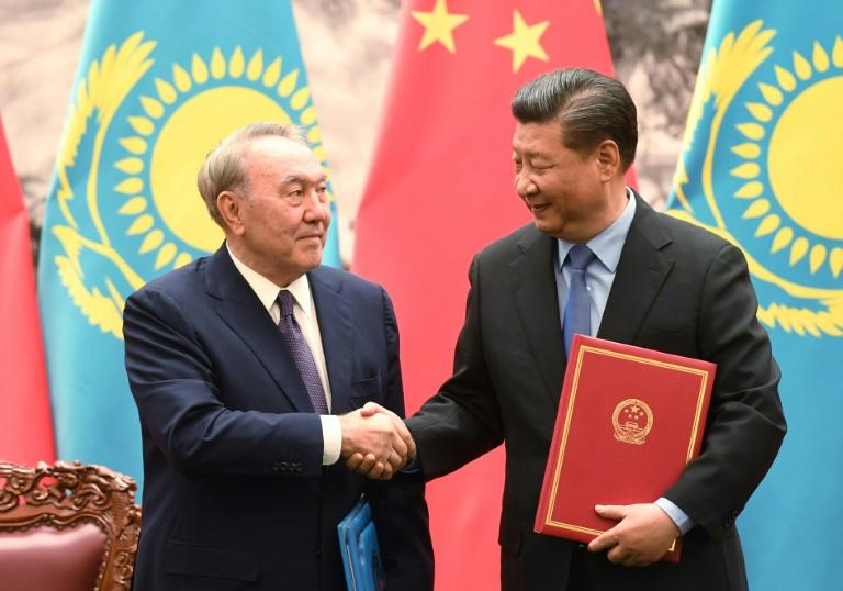 Kazakhstan's President Nursultan Nazarbayev (L) shakes hands with Chinese President Xi Jinping. Kazakhstan is seeking huge investments from its neighbour