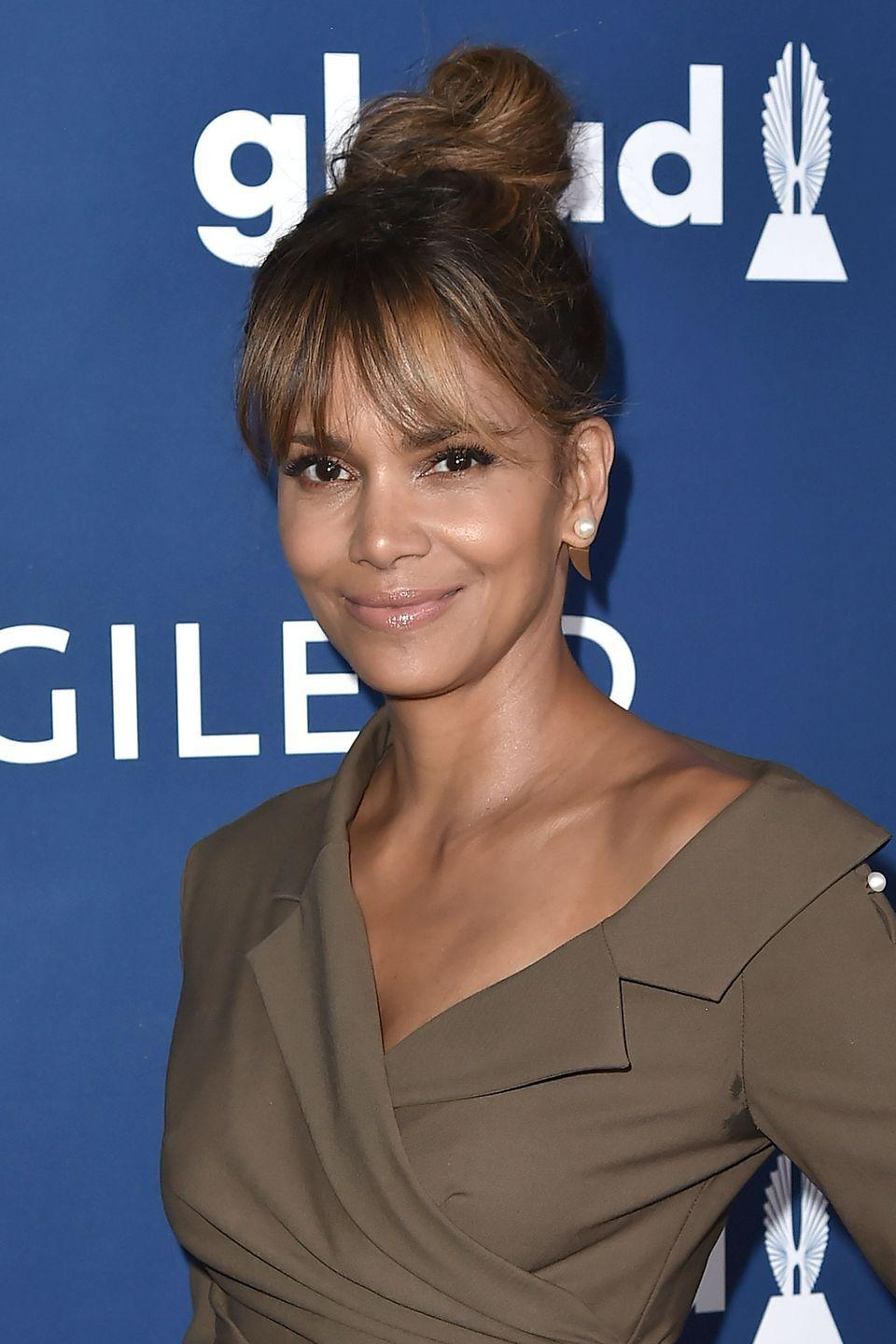 <p>Halle Berry's golden and caramel highlights act like a spotlight to showcase all the soft layers in her wispy fringe.</p>