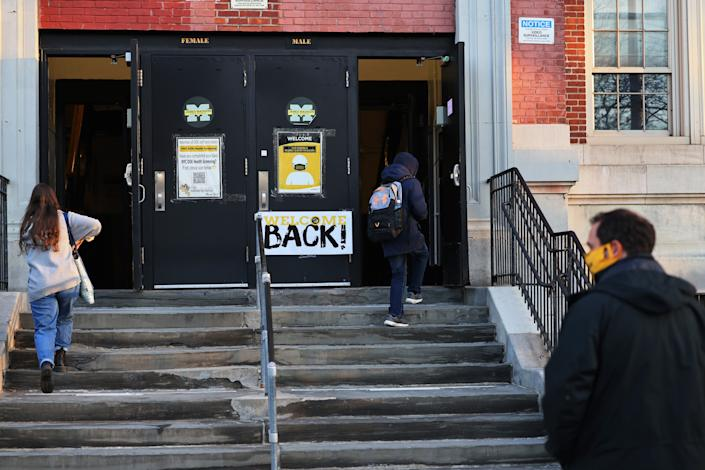 Students prepare to enter James Madison High School on March 22, 2021 in the Madison neighborhood of the Brooklyn borough in New York City. (Michael M. Santiago/Getty Images)