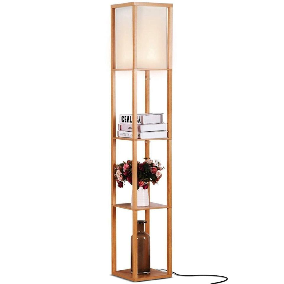 <p>This minimal <span>Brightech Maxwell LED Shelf Floor Lamp</span> ($65) will add both light and storage to your space.</p>