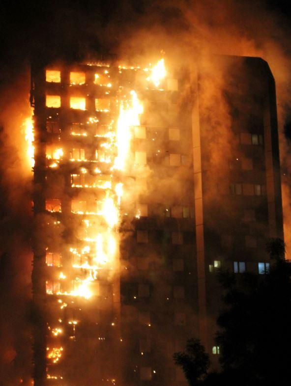 Fire ripped through the tower block in Kensington, west London, on June 14 (Rex)