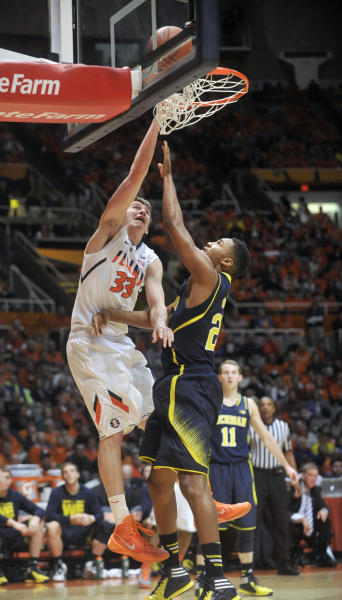 Illinois forward Jon Ekey (33) misses a dunk against Michigan guard Zak Irvin (21) during the first half of an NCAA college basketball game Tuesday, March 4, 2014, in Champaign, Ill. (AP Photo/Rick Danzl)