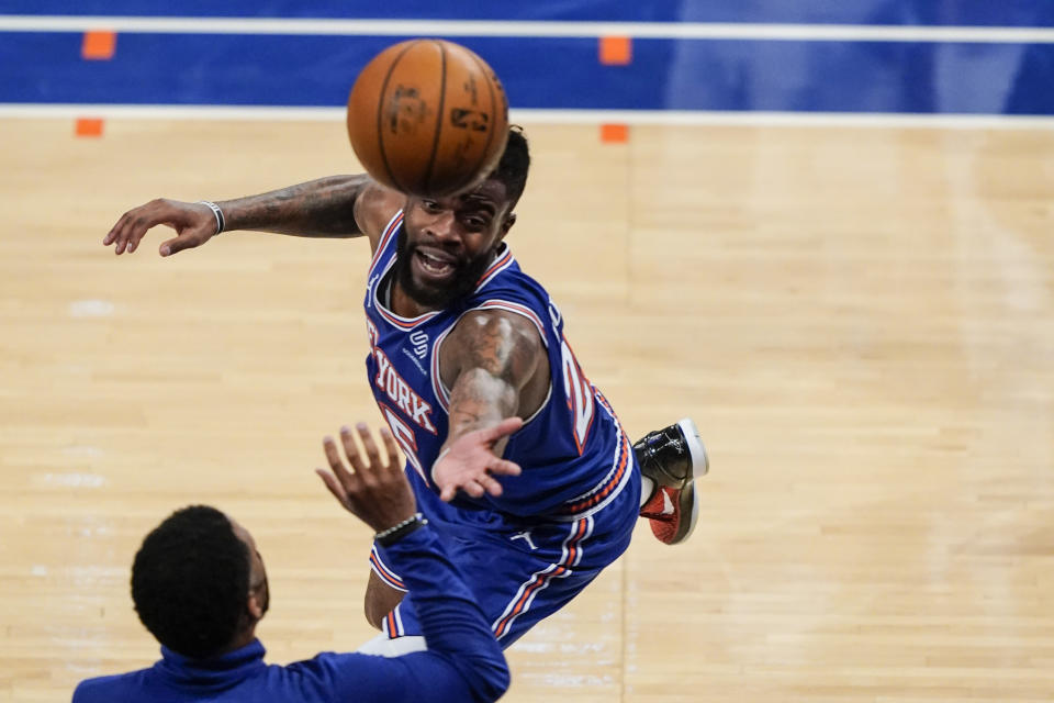 New York Knicks' Reggie Bullock chases a ball out of bounds during the second half of an NBA basketball game against the San Antonio Spurs Thursday, May 13, 2021, in New York. (AP Photo/Frank Franklin II, Pool)