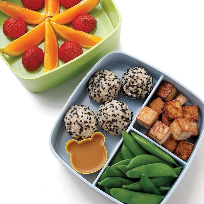 <p>Tofu, rice and vegetables are classic bento ingredients. Make extra rice for dinner and roll leftovers into balls for lunch. To keep green veggies vibrant and crisp, cook them briefly and immediately dunk them into a bowl of ice water. You can also use cubed store-bought baked tofu in place of the roasted tofu.</p>