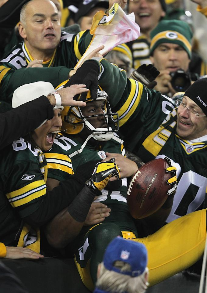 GREEN BAY, WI - NOVEMBER 14:  Greg Jennings #85 of the Green Bay Packers celebrates with fans after he scored on a 24-yard touchdown reception in the first quarter against the Minnesota Vikings at Lambeau Field on November 14, 2011 in Green Bay, Wisconsin.  (Photo by Jonathan Daniel/Getty Images)